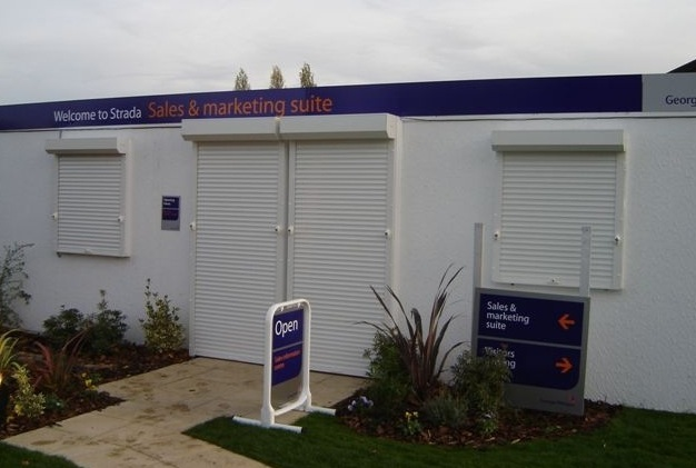 Extruded security window shutters fitted to marketing suite
